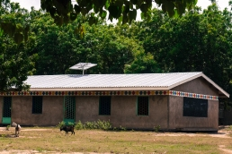 A view of one of the school buildings that now has basic lighting due to MREAP